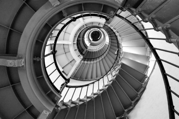 View looking up black and white spiral staircase