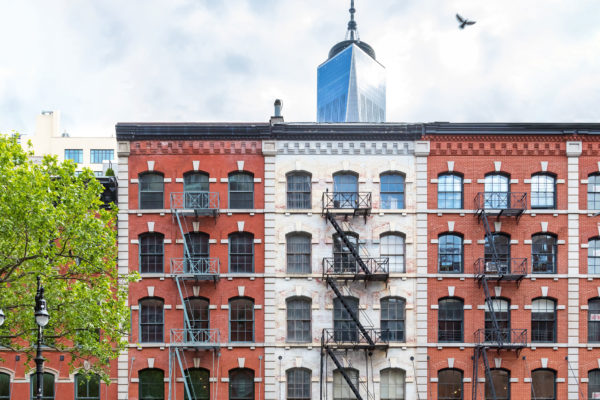 Old brick buildings on Duane Street in Tribeca contrast against