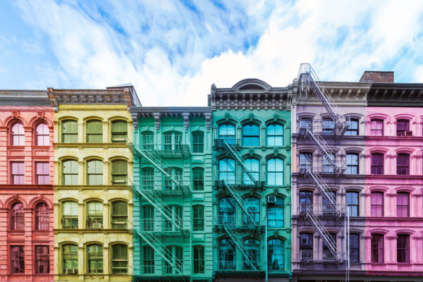 Rainbow colored block of old buildings in the SoHo neighborhood
