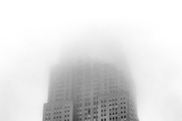 Fog obscures the observation deck of the Empire State Building i